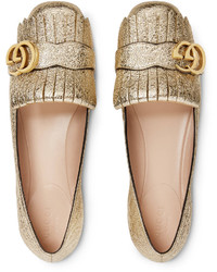 Ballerine in pelle dorate di Gucci