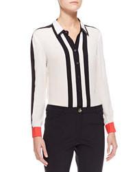 Blusa abbottonata a righe verticali bianca e nera