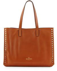 Borsa shopping in pelle con borchie marrone