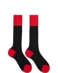Calzini rossi e neri di Prada