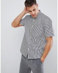 Camicia a maniche corte a righe verticali bianca e nera