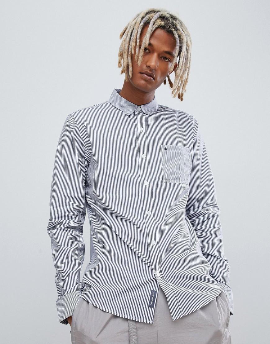 half off a83cf e5f21 Camicia a maniche lunghe a righe verticali blu di Calvin Klein Jeans