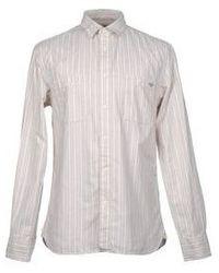Camicia elegante a righe verticali beige