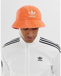 Cappello alla pescatora arancione di adidas Originals