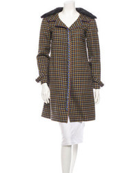 Cappotto con collo di pelliccia marrone