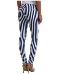 Jeans aderenti a righe verticali bianchi e blu scuro