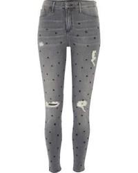 Jeans aderenti con stelle grigi