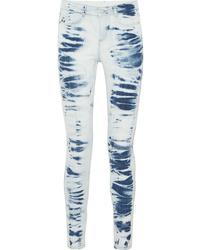 Jeans aderenti effetto tie-dye azzurri