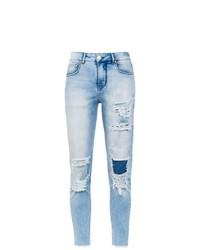 Jeans aderenti strappati azzurri di Amapô