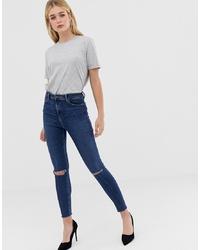 Jeans aderenti strappati blu scuro di ASOS DESIGN