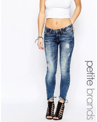 Jeans aderenti strappati blu