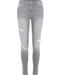 Jeans aderenti strappati grigi