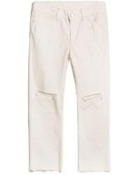 Jeans boyfriend strappati bianchi
