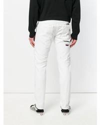 Jeans strappati bianchi di Marcelo Burlon County of Milan