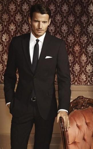 Vestito nero camicia bianca cravatta nera