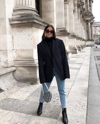 Per creare un look adatto a un pranzo con gli amici nel weekend punta su un blazer nero e jeans azzurri. Calza un paio di stivaletti in pelle neri per donna di Asos per mettere in mostra il tuo gusto per le scarpe di alta moda.