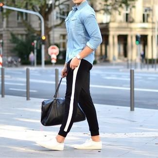 Come indossare e abbinare un borsone in pelle nero per un