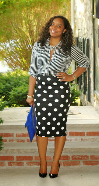 ... Look alla moda per donna  Camicia elegante a righe verticali nera e  bianca 3801c6c991f