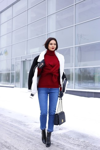 Distinguiti anche negli ambienti più alla moda con un giubbotto di shearling nero e bianco e jeans blu. Impreziosisci il tuo outfit con stivaletti stringati eleganti in pelle neri.