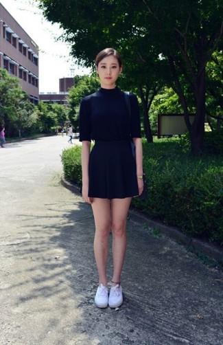 ... Look alla moda per donna  Maglione a maniche corte nero 70c49c71815
