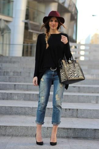 Look alla moda per donna: Maglione oversize nero, Jeans