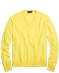 Maglione con scollo a v giallo
