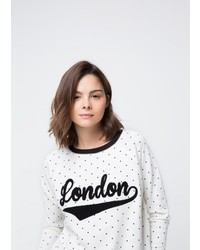 Maglione girocollo a pois bianco e nero