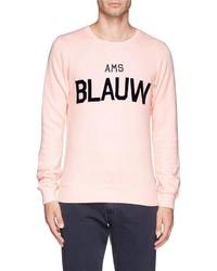 Maglione girocollo stampato rosa