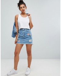 Minigonna di jeans strappata azzurra di Chorus