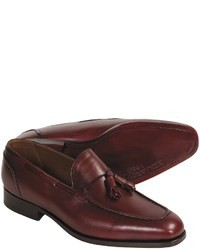 Mocassini con nappine in pelle bordeaux