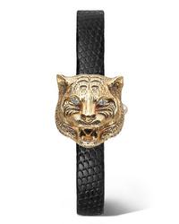 Orologio dorato di Gucci