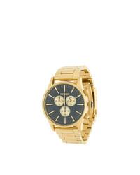 Orologio dorato di Nixon