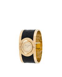 Orologio nero e dorato di Gucci