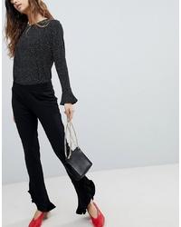 Pantaloni a campana neri di Soaked in Luxury