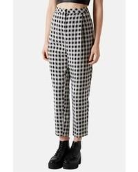 Pantaloni eleganti a quadretti bianchi e neri