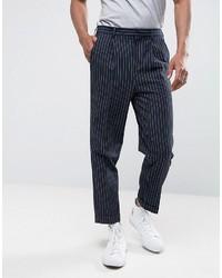 Pantaloni eleganti a righe verticali blu scuro di Asos