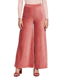 Pantaloni larghi di velluto a coste fucsia