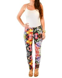 Pantaloni skinny a fiori neri