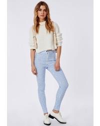 Pantaloni skinny a quadri bianchi e blu