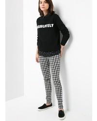 Pantaloni skinny a quadri neri e bianchi