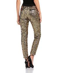 Pantaloni skinny con paillettes dorati