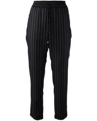 Pantaloni stile pigiama a righe verticali neri di Stella McCartney
