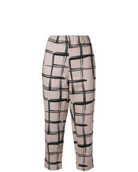 Pantaloni stretti in fondo a quadri beige