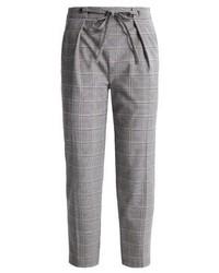 Pantaloni stretti in fondo a quadri grigi di Topshop