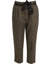Pantaloni stretti in fondo a quadri marroni