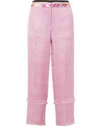 Pantaloni stretti in fondo a quadri rosa