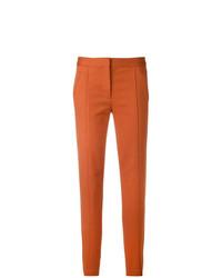 Pantaloni stretti in fondo arancioni di Tory Burch