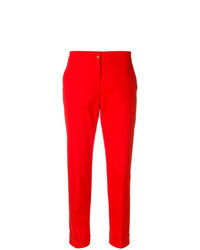 Pantaloni stretti in fondo rossi