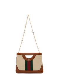 Pochette in pelle stampata marrone chiaro di Gucci