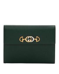 Pochette in pelle verde scuro di Gucci